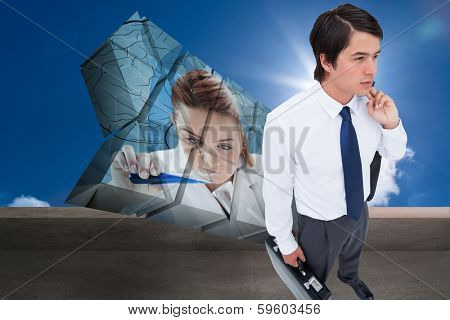 Young tradesman with his jacket and suitcase against balcony and bright blue sky