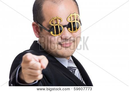 Rich businessman wear dollar sign glasses pointing to you