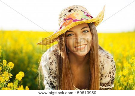 Happy Woman In A Hat Of Wildflowers