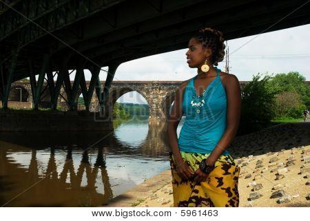 Lady Stands Under The Bridge