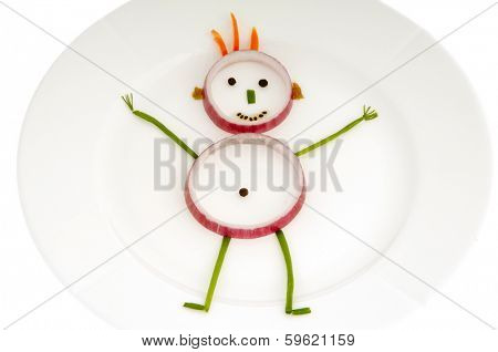 Man made out of vegetables on a dish
