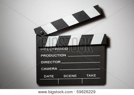 Clapperboard cinema on white