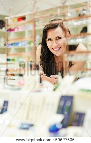 Happy woman shopping in jewelry store for accessoires