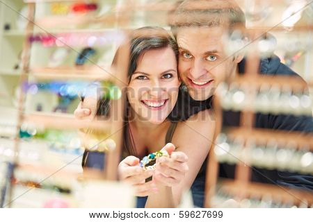 Happy couple shopping for bangle at jewelry store