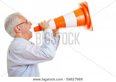Old angry man screaming loudly in a pylon