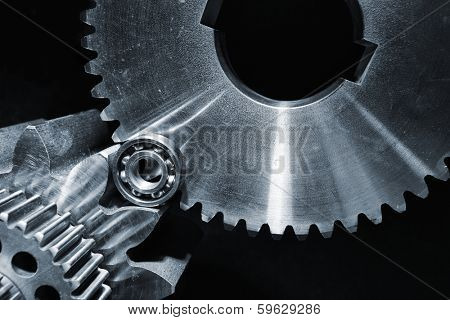 aerospace titanium gears and cogs set against black background