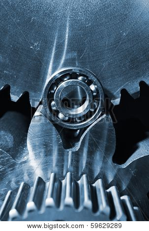 gears, cogwheels and ball-bearing close-ups, titanium and steel
