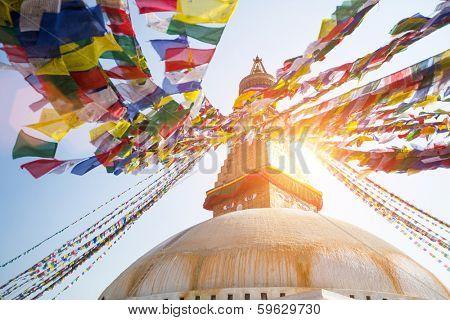 Bodhnath Stupa in Kathmandu, shot against the sun.