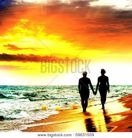 Couple Walk On The Beach