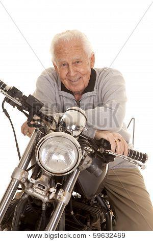 Elderly Man On Motorcycle Close Smile
