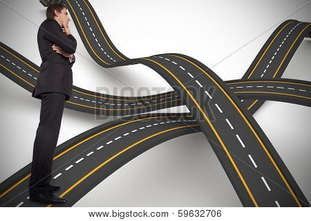 Thinking businessman touching chin against bumpy road background