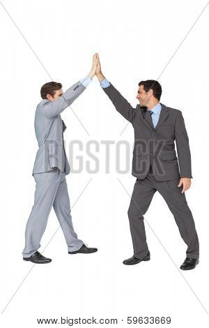Unified business team high fiving each other on white background