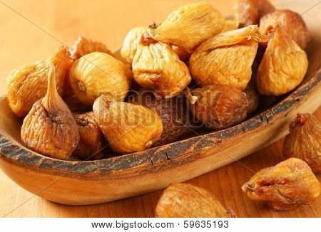 naturally dried figs served on a wooden tray