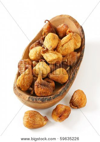 naturally dried unsweetened figs served on a wooden tray