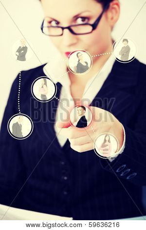 Businesswoman choosing the right worker of all applicants on an abstract button.