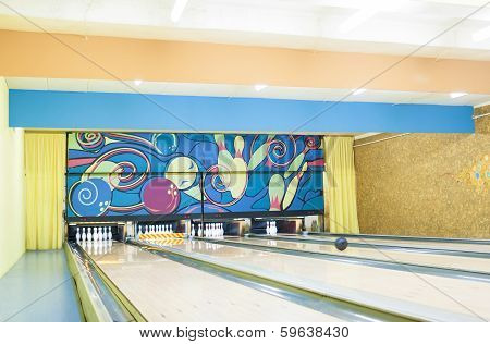 Bowling Playground Lanes With One Ball Rolling