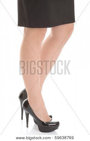 Business woman's legs and black high heels. Isolated on white.
