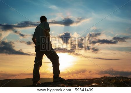 Silhouette of man in mountain. Conceptual scene.