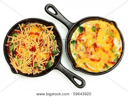 Uncooked Raw Eggs in Skillet with Brocoli, Cheese and Sriracha Sauce over white.