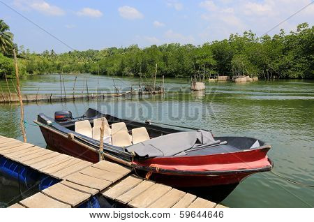 motor boat on river near moorage