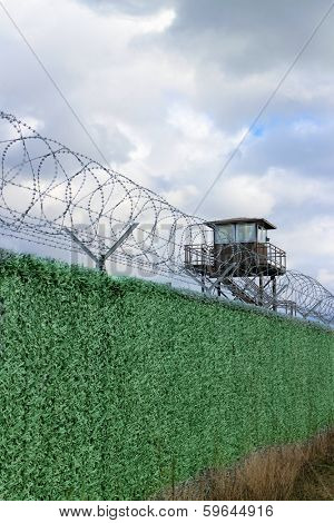 Fence in a military camp with watchtower