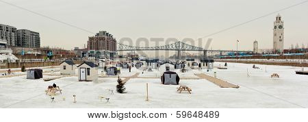 Ice fishing in Montreal downtown, on the st-Lawrence river during winter.