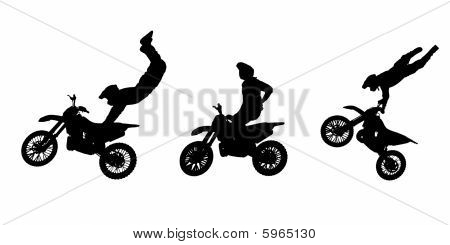 Silhouettes of motorbike stunts