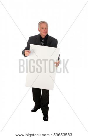 A Handsome Middle Aged Business Man points to and holds a white sign with room for your text or image. The perfect Sign Holding image for all your advertising needs. Images & text are replaceable