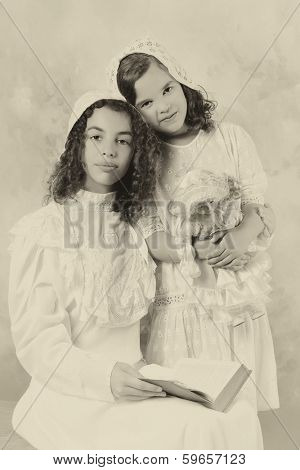 Vintage photo of two victorian sisters posing in the old-fashioned style