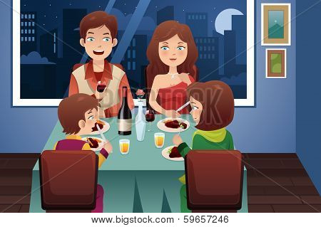 Family Having Dinner In A Modern House