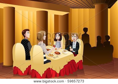 Family Eating Out In A Restaurant