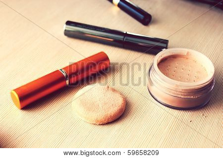 Compact pocket powder and a powder puff and other cosmetics