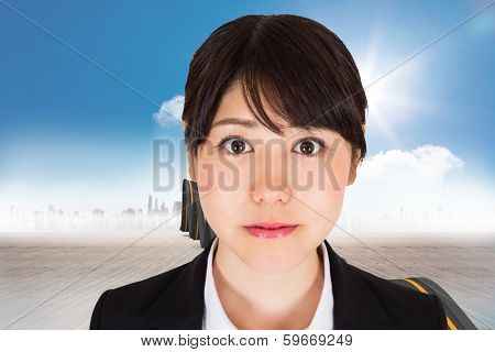 Serious businesswoman against bumpy road leading to city