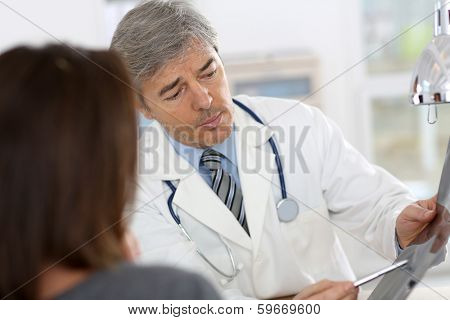 Doctor showing X-ray result to patient