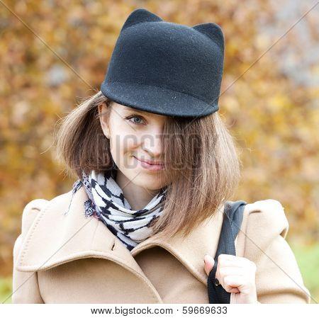 Beautiful Young Woman wearing cap. Autumn style.