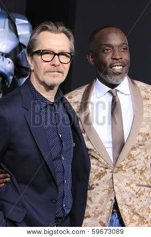 LOS ANGELES - FEB 10: Gary Oldman, Michael Kenneth Williams at the premiere of Columbia Pictures' 'Robocop' at TCL Chinese Theatre on February 10, 2014 in Los Angeles, California