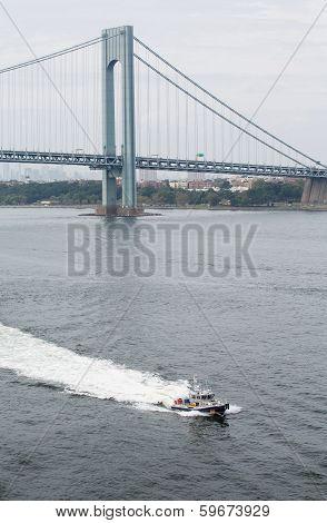 New York Police Boat Cruising Under Verrazano Bridge