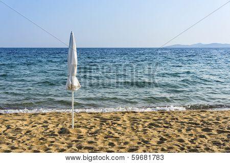 Closed Umbrella Near By The Seashore