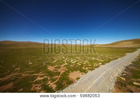 Green Plains With Mountain Landscape