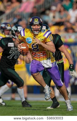 VIENNA,  AUSTRIA - APRIL 21 QB Christoph Gross (#8 Vikings) runs with the ball during the AFL football game on April 21, 2013 in Vienna, Austria.