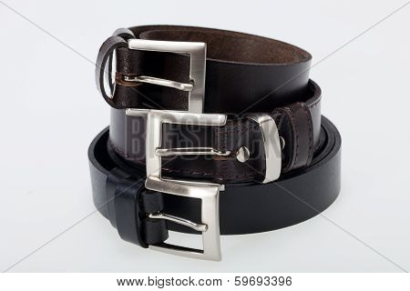 Colose up of Men black belt isolated on white.