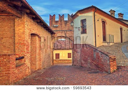 Narrow cobbled street in old historic center of Monticello D'Alba - small town in Piedmont, Northern Italy.