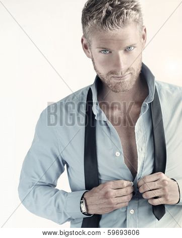 Sexy portrait of a young confident businessman