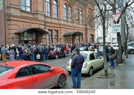KRASNODAR, RUSSIA - FEBRUARY 11, 2014: Hundreds wait in the line for spectator pass to the XXII Winter Olympics in Sochi, Russia. People spent 6 and more hours for getting the pass