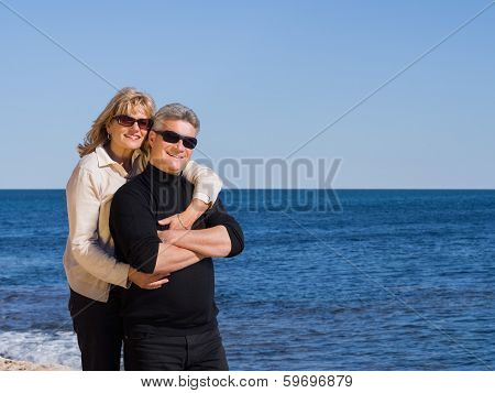 Happy Romantic Middle-aged Couple At The Sea