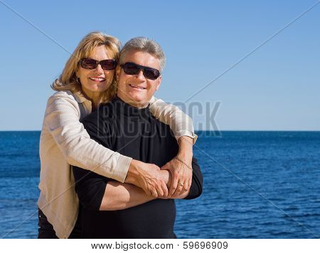 Romantic Mature Man And Woman Enjoying The Seaside