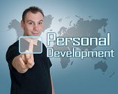 foto of self assessment  - Young man press digital Personal Development button on interface in front of him - JPG