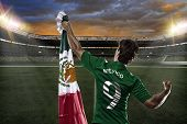 foto of mexican  - Mexican soccer player celebrating with the fans - JPG