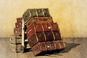 stock photo of piles  - A Vintage Grunge Photograph of a Pile of Old Suitcases  - JPG