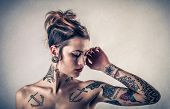 stock photo of piercings  - tattooed lady - JPG